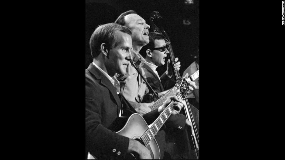 Seeger, center, appears as a musical guest on the Smothers Brothers Comedy Hour with Tom Smothers, left, and Dick Smothers in 1967.