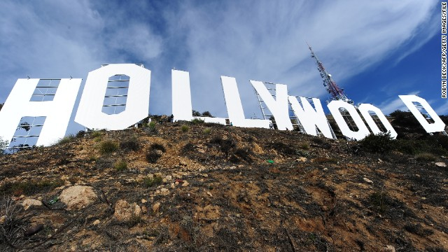 The freshly painted Hollywood Sign is seen after a press conference to announce the completion of the famous landmark's major makeover, December 4, 2012 in Hollywood, California. Some 360 gallons (around 1,360 liters) of paint and primer were used to provide the iconic sign with it most extensive refurbishment in almost 35 years in advance of it's 90th birthday next year. AFP PHOTO / Robyn Beck (Photo credit should read ROBYN BECK/AFP/Getty Images)