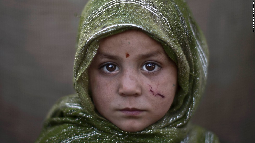 Madina Juma'a, 4 -- Associated Press chief photographer in Pakistan, Muhammed Muheisen, photographed  Afghan children in a slum on the outskirts of Islamabad.