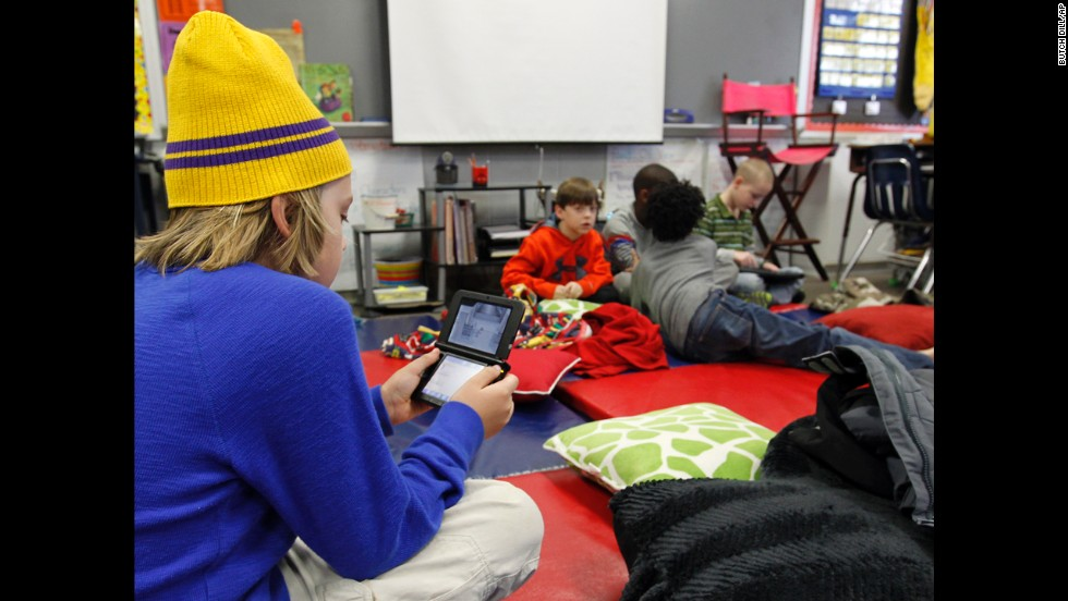 "Gavin Chambers plays an electronic game January 29 at Oak Mountain Intermediate School in Indian Springs, Alabama. The <a href=""http://www.cnn.com/2014/01/28/us/winter-weather/index.html"">severe weather forced thousands</a> of students to spend the night in various school buildings across the state."