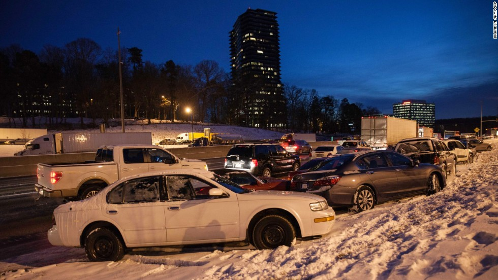 Abandoned vehicles in Dunwoody, Georgia, line Interstate 285 early on January 29.
