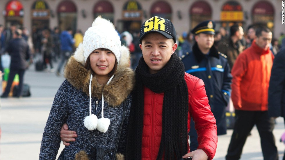 Married couple Wang Zhiyuan (R) and Wang Chenyang (L) from Baicheng, Jilin province, came to Beijing six years ago. Wang first studied in medical school and now works in a hospital's pharmacy in Chaoyang district. His wife sells massage machines.
