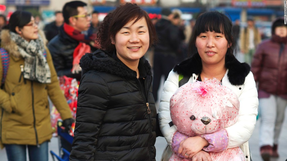 Wang Xia (L), 30, and Xie Guangxia (R), 28 are sales workers in a garment shopping mall. They've been working in Beijing since they left Anhui province 10 years ago.