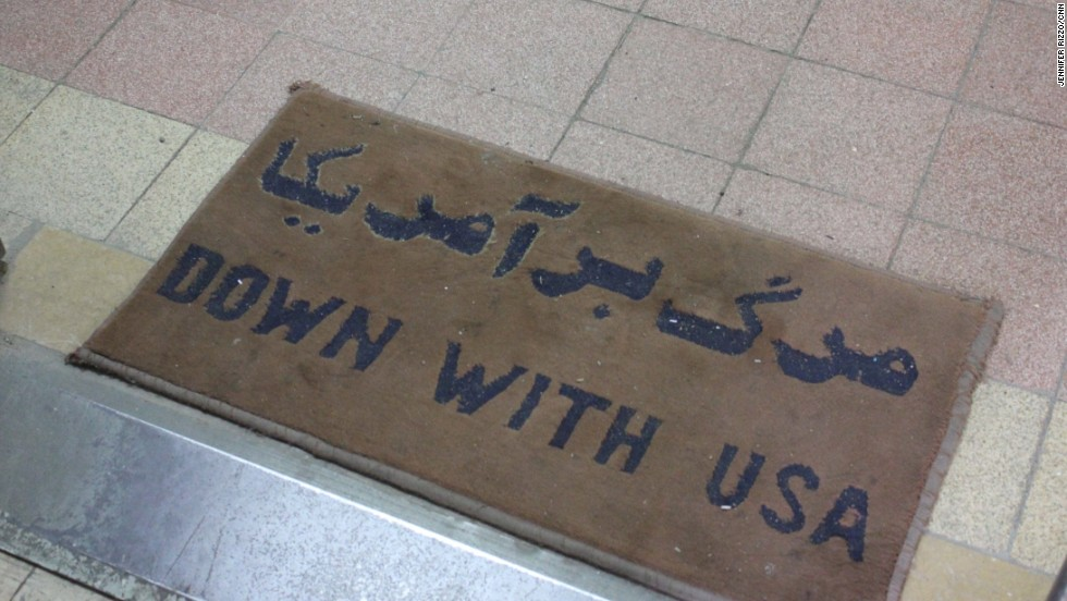 "This mat, which lies at the entrance to the secure part of the embassy, is an example of the anti-American propaganda there today. In Farsi, the writing says ""Death to America."""