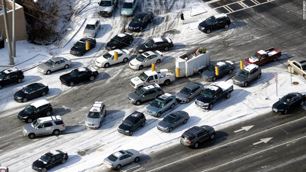 Abandoned cars are piled up on the median of an ice-covered road in Atlanta on January 29.