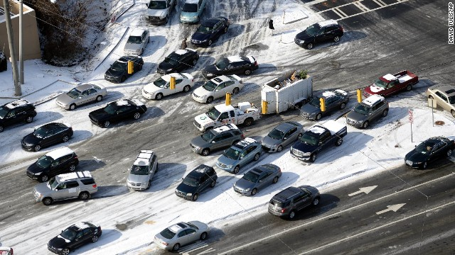 Abandoned cars are piled up on the median of icy Cobb Parkway in Atlanta.