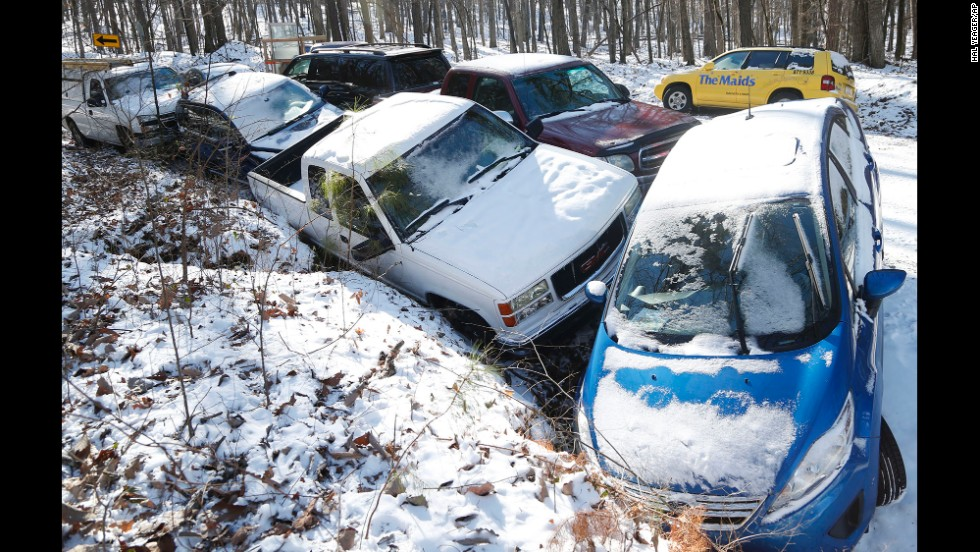 Cars are left abandoned at the bottom of a hill in Birmingham, Alabama, on January 30.