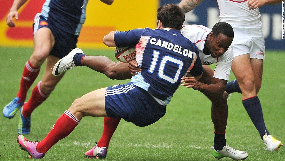 France's Julien Candelon is on the receiving end of a tackle by Isles during last year's Hong Kong Sevens tournament.