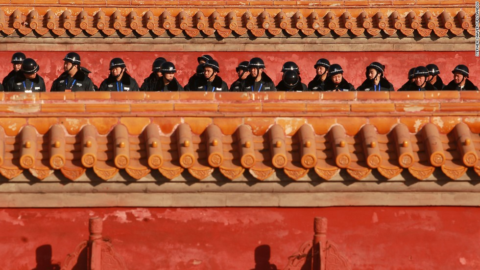 Chinese police prepare to provide security at a Lunar New Year ceremony at Ditan Park in Beijing on January 30.