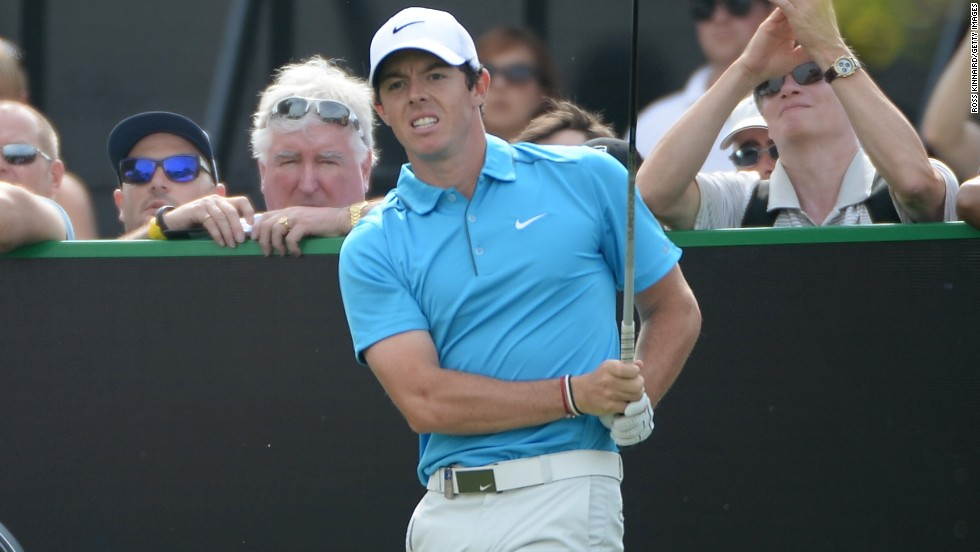 Rory McIlroy watches a tee shot during his third round at the Dubai Desert Classic at the Emirates Golf Club.