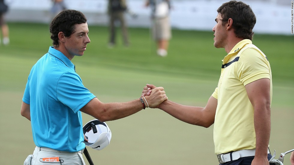 McIlroy, the 2009 Dubai winner, shakes hands with third-placed playing partner Brooks Koepka of the U.S.