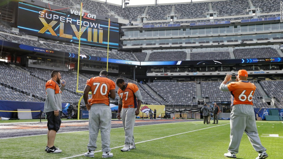 Denver Broncos players Louis Vasquez, left, Vinston Painter, Winston Justice, and Manny Ramirez  look around MetLife Stadium before the team's walk-through on February 1.