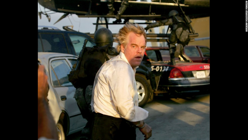 "Hoffman como Owen Davian ""Mission: Impossible III"" (2006)."