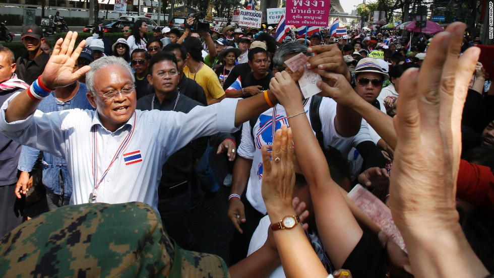 Protest leader Suthep Thaugsuban greets supporters during a march in Bangkok, Thailand, on Monday, February 3. Anti-government protesters disrupted voting in roughly one-fifth of Thailand's electoral districts in national elections Sunday, February 2, authorities said.
