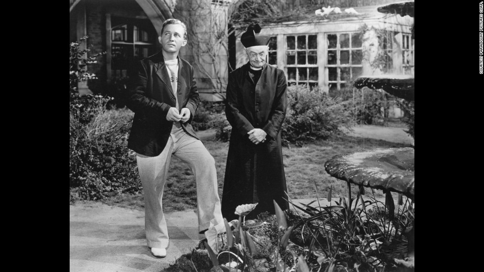 "Hollywood's favorite crooner became its favorite priest. Bing Crosby, left, won the best actor award as Father Chuck O'Malley in ""Going My Way."" He encountered resistance from a crusty old priest (Barry Fitzgerald) when he tried to help an impoverished church parish."