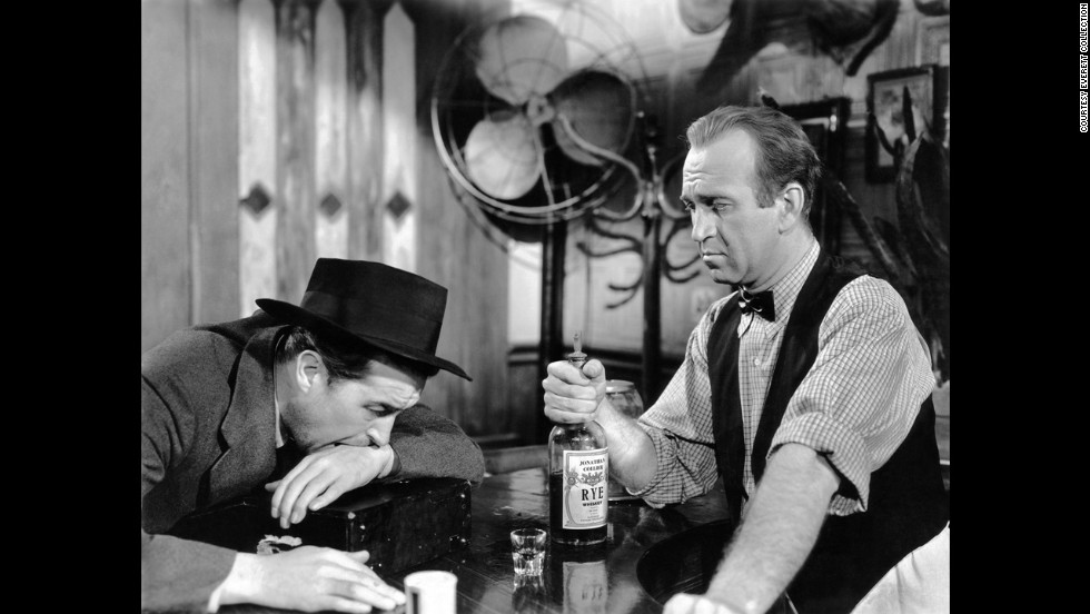 "With World War II coming to an end, Hollywood turned to dark subject matter, such as alcoholism in Billy Wilder's ""The Lost Weekend."" Star Ray Milland, left, won the best actor award as a writer on a binge. Howard Da Silva was the bartender."