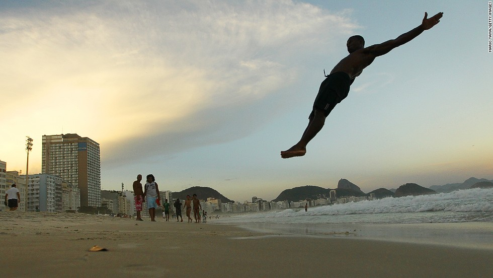 FEBRUARY 3 - RIO DE JANEIRO, BRAZIL: Circus performer Maicon Gomes does a set of flips for his friends on Copacabana Beach following the Alegria da Zona Sul pre-Carnival street parade on February 2. Rio Carnival, the world's biggest carnival, officially begins on February 28.