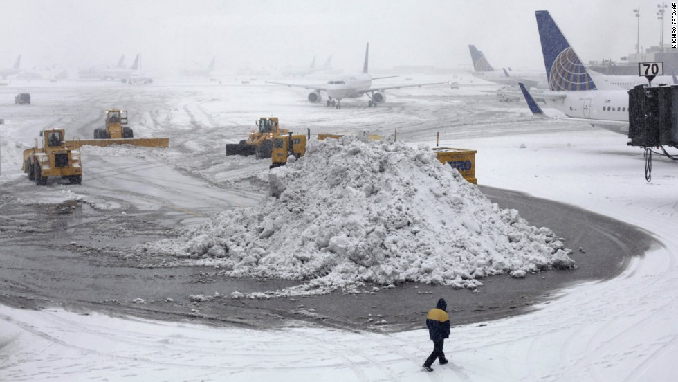 Plows clear runways February 3 at Newark Liberty International Airport.