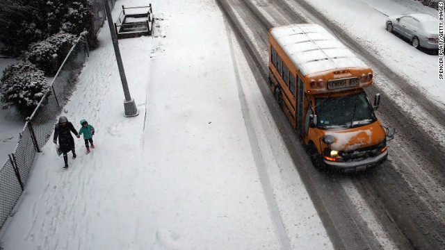 A school bus drives down the street during a snowstorm in Brooklyn, New York, on February 3.
