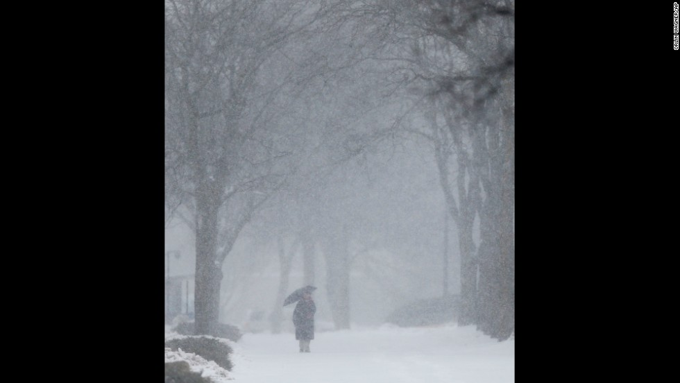 A woman makes her way through the snow on the University of Kansas campus in Lawrence on February 4.