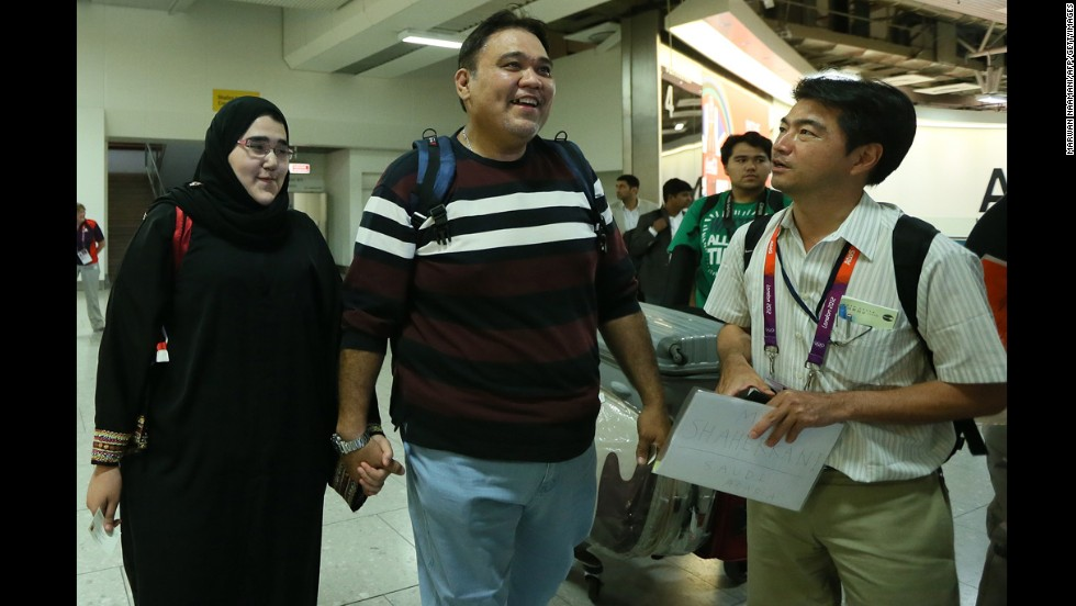 Saudi judo athlete Wojdan Shaherkani arrives with her father, Ali, for the 2012 Olympic Games.