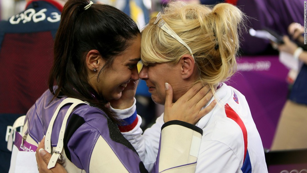 Serbian sport shooter Ivana Maksimovic, left, hugs her mother and coach, Miriban, after winning a silver medal at the London Games.