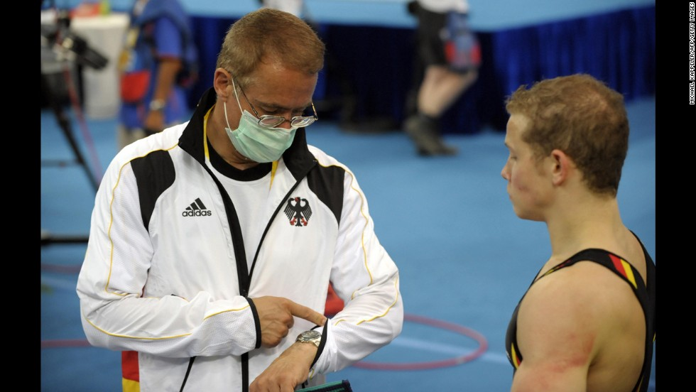 German gymnast Fabian Hambuchen, right, talks to his father and coach, Wolfgang, during a training session before the 2008 Olympics.