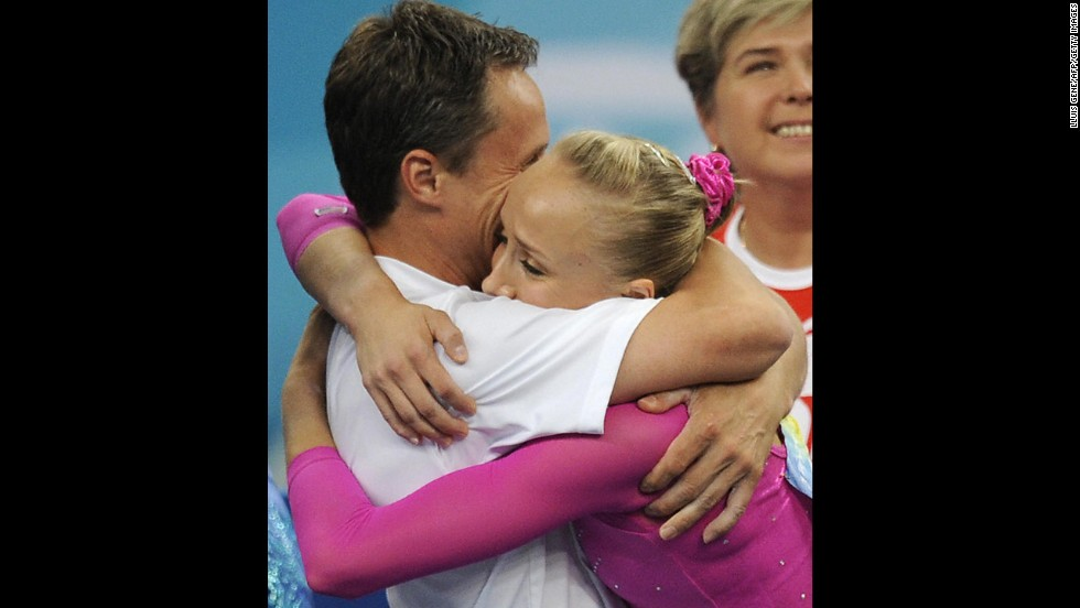 American gymnast Nastia Liukin celebrates with her father and coach, Valeri, after winning gold in the individual all-around at the Olympics in 2008.