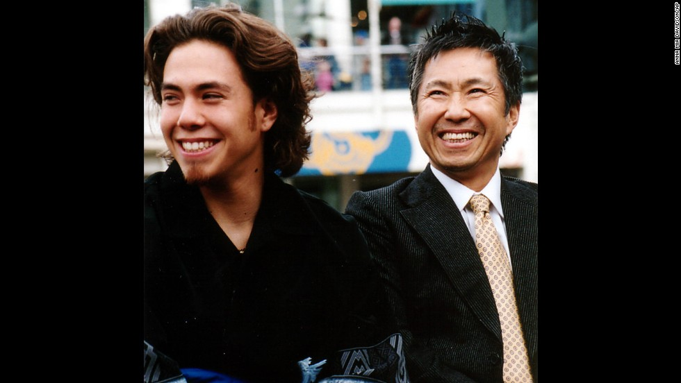 American speed skater Apolo Anton Ohno and his father, Yuki, smile as Apolo Anton Ohno Day is announced in Seattle in 2002.