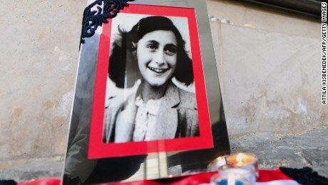 A portrait of Anne Frank stands in front of the memorial of Central Europe's first Holocaust museum in Budapest.