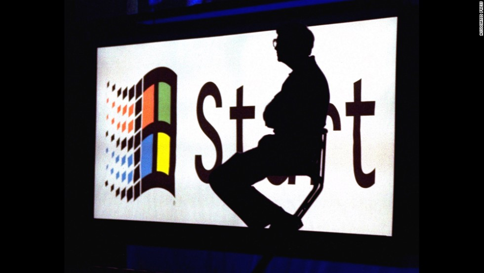Gates sits on stage during a video portion of the Windows 95 launch event on August 24, 1995, on the company's campus in Redmond, Washington. A Harvard University dropout, Gates co-founded Microsoft with Paul Allen in 1975.