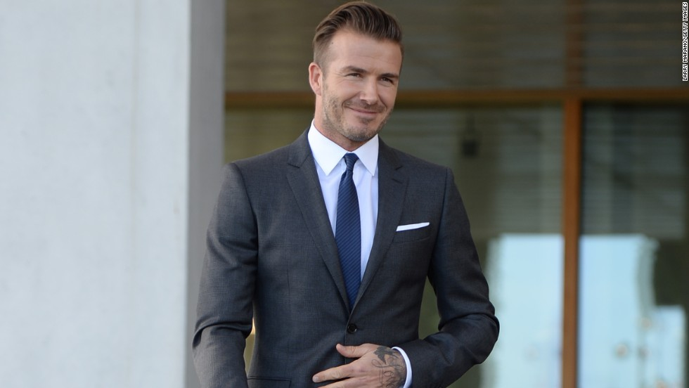 Yes, David Beckham really does look this great while attending a press conference in Miami on February 5.