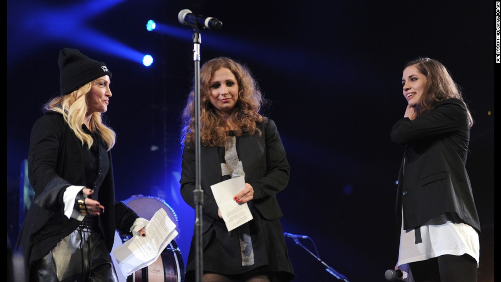 Pop star Madonna, left, introduces Maria Alyokhina and Nadezhda Tolokonnikova, the two Pussy Riot members who were imprisoned, at an Amnesty International concert held Wednesday, February 5, in New York City.