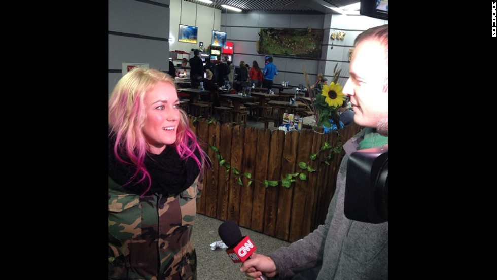 Lee interviews American snowboarder Faye Gulini after she arrived in Sochi on February 6.