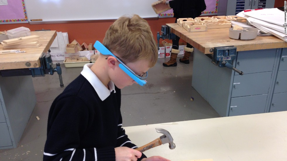 A young student uses Google Glass to record his work in art class at the Episcopal Academy in Newtown Square, Pennsylvania. Margaret Powers, who coordinates technology for the private school's youngest students, was selected for Google's Glass Explorer program, which allows people to test the wearable computer.