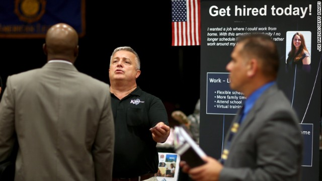 MIAMI, FL - OCTOBER 22: Hans Kahl (C) speaks with prospective employees as he recruits for his company, KahlCenter, during a job fair for veteran job seekers at the Harvey W. Seed American Legion Post 29 on October 22, 2013 in Miami, Florida. The Labor Department announced today that employers added 148,000 jobs in September, lengthening a summer slowdown in payroll growth. The unemployment rate fell to 7.2 percent from 7.3 percent. (Photo by Joe Raedle/Getty Images)