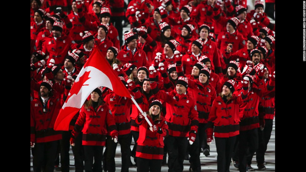 The Canadians, led by hockey player Hayley Wickenheiser, enter the stadium.