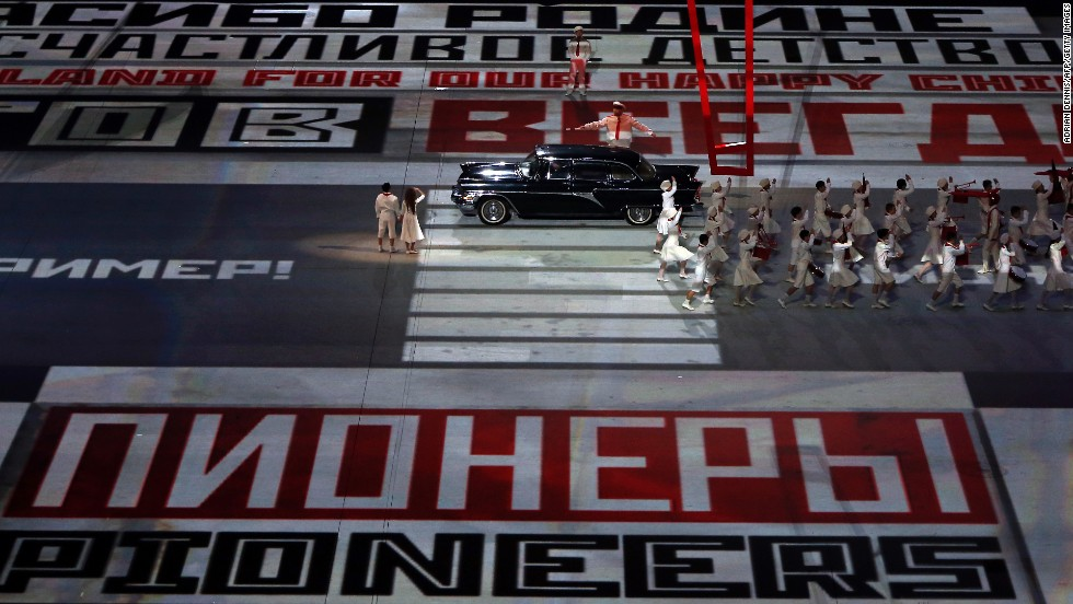 Text is projected on the floor of the stadium.