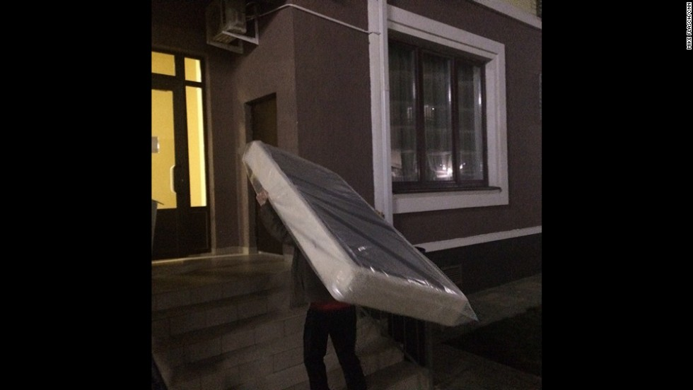 Flasch also snapped this image of a mattress being carried into a Sochi hotel on Thursday, February 6.
