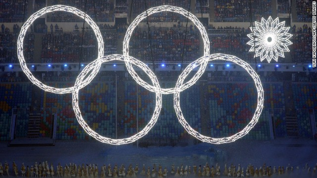 Performers sing as the Olympic rings are presented during the Opening Ceremony of the Sochi Winter Olympics at the Fisht Olympic Stadium on February 7, 2014 in Sochi.
