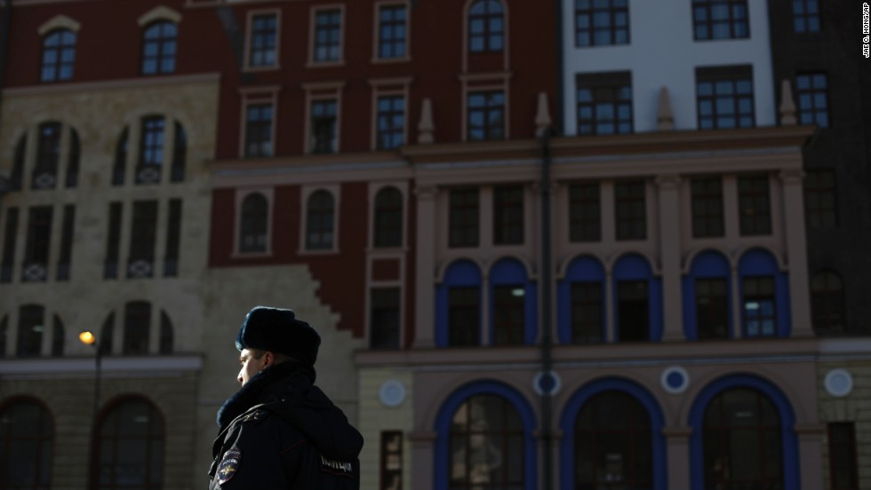 A police office guards the street outside hotel buildings in Krasnaya Polyana on February 7.