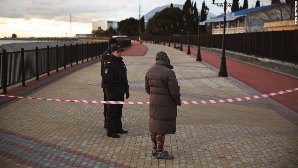 A woman is turned away by police at a barricade blocking the boardwalk near the Fisht Olympic Stadium in Sochi on February 6.