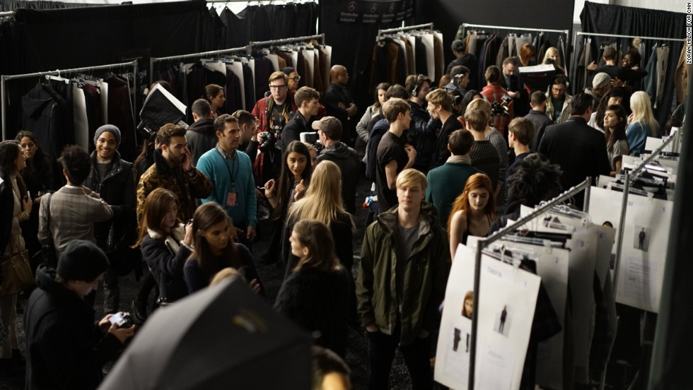 It may seem calm out front to audience members, but backstage is a flurry of activity for stylists before the Richard Chai show.