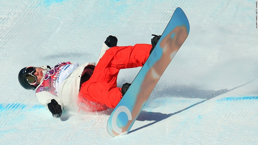 Snowboarder Lucien Koch of Switzerland falls during the men's slopestyle semifinals on February 9.