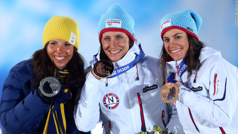 (From left to right) Silver medalist Charlotte Kalla of Sweden, Marit Bjoergen and bronze medalist Heidi Weng also from Norway.