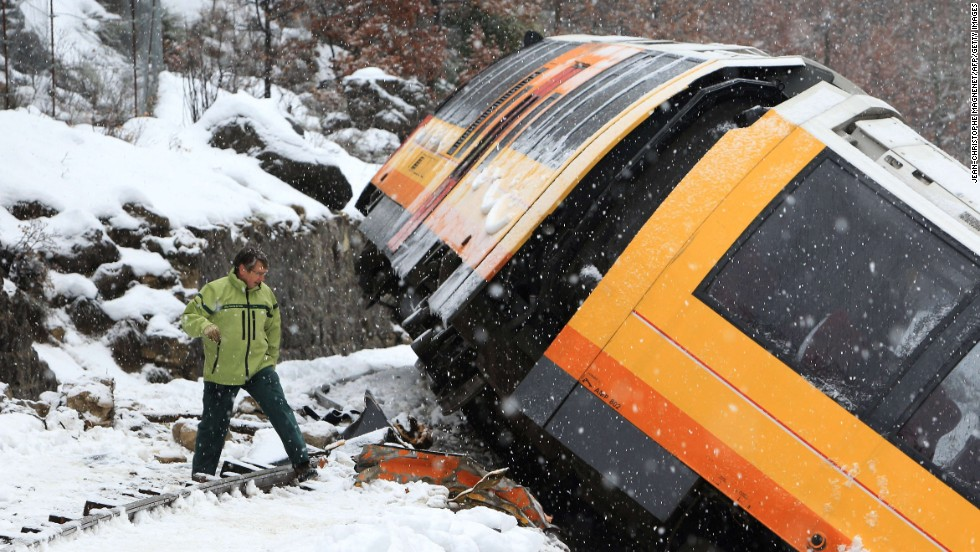 A man inspects the wreckage of the train.
