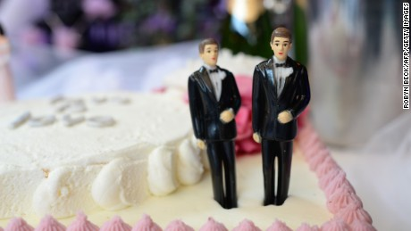 A wedding cake with a male couple is seen at The Abbey restaurant at a celebration of the over100 same-sex marriages performed today in West Hollywood, California, July 1 2013.. The U.S. Ninth Circuit Court of Appeals lifted California's ban on same-sex marriages just three days after the Supreme Court ruled that supporters of the ban, Proposition 8, could not defend it before the high court. AFP PHOTO / ROBYN BECK (Photo credit should read ROBYN BECK/AFP/Getty Images)
