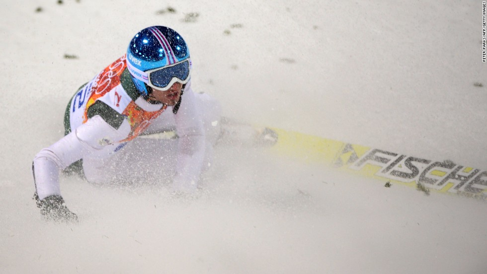 Slovenia's Robert Kranjec lies in the snow after falling in the men's normal hill ski jumping event Saturday, February 8.