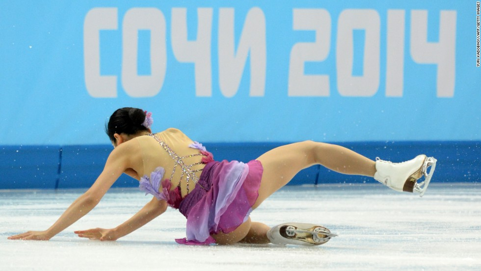 Japan's Mao Asada falls as she performs in the team figure skating event on February 8.