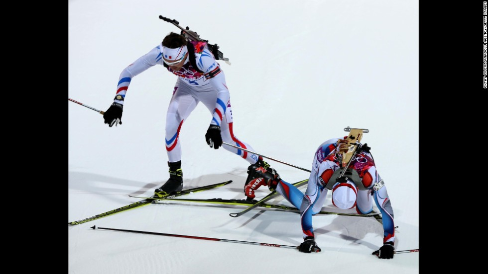 Biathletes Simon Desthieux of France and Ondrej Moravec of the Czech Republic get their skis tangled during the 10-kilometer sprint February 8.